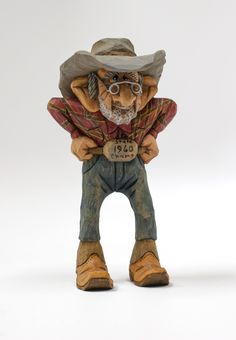 Rowdy the Cowboy carved by Dale Green is always ready for action.