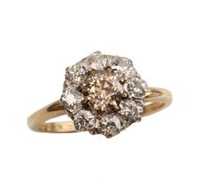 Champagne Diamond Cluster Ring  Circa 1900-1910 platinum on gold with European diamond cluster ring and champagne center diamond.    Size 6.5, can be sized.