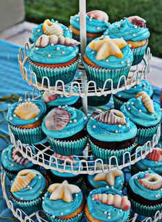Barbie Mermaid party for my daughter. Cupcakes made with candy mold seashells. Easy to mix two melted candy melts and added pearl ediable beads and blue sprinkles. Kids loved them & thought they were real sea shells:)