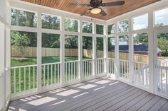 Classic Cottages sold home in Falls Church, Virginia featuring open concept sunroom/screened porch with fan lighting and spacious windows for optimal natural light.