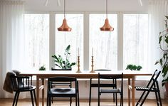 Use pendant lamps to make your dining table the focus of the room | #IKEAIDEAS #diningtable #lighting