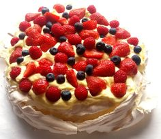 Sweet and delicious pavlova! Crisp meringue and sweet custard with delicious fruit make a fantastic combination. Pavlova Recipe, Raspberry Preserves, Delicious Fruit, Lemon Curd, Serving Platters, Baking Pans, Custard, Let Them Eat Cake, A Food