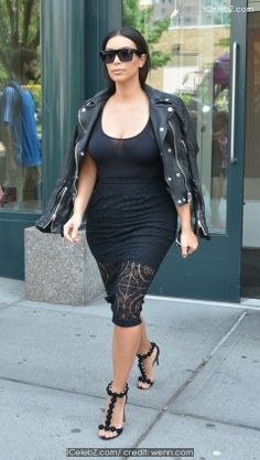 Kim Kardashian Newlywed Kim Kardashian spotted in Soho dressed in black from head-to-toe http://icelebz.com/events/newlywed_kim_kardashian_spotted_in_soho_dressed_in_black_from_head-to-toe/photo1.html