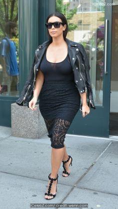 Kim Kardashian Newlywed Kim Kardashian spotted in Soho dressed in black from head-to-toe http://icelebz.com/events/newlywed_kim_kardashian_spotted_in_soho_dressed_in_black_from_head-to-toe/photo1.html