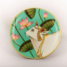 Inspired by Indian ethnic paintings, this wooden plate with hand-painted cow is sure to add a traditional touch to your décor. The beauty and serenity of this painting is mesmerizing. Cow Painting, Mural Painting, Fabric Painting, Wooden Painting, Pichwai Paintings, Indian Art Paintings, Princess Painting, Purple Turtle, Hand Painted Walls