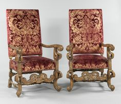 In the Italian manner, with ornately carved wood frames, scrolling arms, legs and apron, turned stretcher bars, upholstered in a red antiqued velvet printed in gold with a leafy design reminiscent of Fortuny patterns. The wood has been finished in a distressed rustic finish with patches of gilt. Furniture, Wood, Carved Wood Frame, Chair, Home Decor, Fortuny, Armchair, Dining Chairs, Gilt