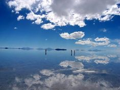 """The world's largest salt flat is located in Salar de'Uyuni, Bolivia. During the rainy season, the inability of the saturated salt solution to infiltrate into the ground creates, in effect, the world's largest """"mirror"""". The reflection from the sky creates a sense of infinity…"""