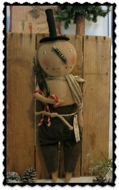 Handmade Primitive Snowman with Candy Canes