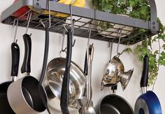 Hanging Pot Rack  ~~  We aren't using the window between the kitchen and dining room, anyway.  Could hang the pots in front of it.  ~~  | Easy Storage Ideas for Small Spaces