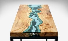 Klassen design of table made of wood and blue glass describing a river... So unique!