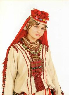 Erzya young lady> http://en.wikipedia.org/wiki/Erzya_language > http://en.wikipedia.org/wiki/Mordvins