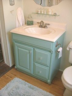 Paint a bathroom cabinet an unexpected color.  Perfect for older, ugly cabinetry that needs a cheap update. Perfect for our bathroom