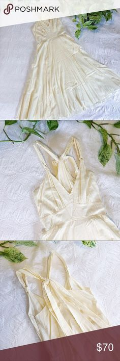 """Varitas of California (Anthropologie) Midi Dress Varitas of California (Anthropologie) Ivory Midi Dress. Gorgeous lightweight midi dress. 100% cotton. Size XS - only worn once. Purchased at Anthropologie about 12 years ago. Has two very small stains near bottom - otherwise in excellent condition. I'm 5'2"""" and it reaches mid-calf length. Anthropologie Dresses Midi"""