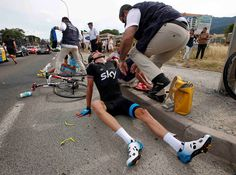 Team Sky rider Geraint Thomas of Britain sits on the road after a crash