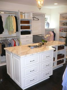 A master closet with enough room to house an entire dressing island is simply wonderful, offering additional storage and a place to lay out your fine jewelery and cell phone.