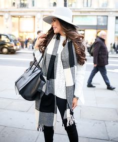NOVEMBER 13, 2015 Chunky Cable Knit Sweater in London - SWEATER: 1.State (it is oversized, the perfect sweater for the holidays, too!) | LEGGINGS: Zella | SCARF: Monki (very similar w/smaller print buffalo plaid here) | BAG: Celine (craving THIS black bag!) | BOOTS: Stuart Weitzman (similar styles HERE & HERE that are dupes) | HAT: Janessa Leone (dupe for it here!) | EARRINGS: J.Crew | WATCH: Michele | RING: BaubleBar  | LIPS: Rebel