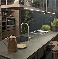 Adore this industrial kitchen with bamboo and pro green tones