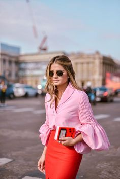 romantic sleeves on a pink blouse paired with a red pencil skirt