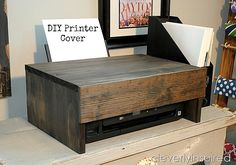 If you prefer to keep your printer out and about cover the plastic appliance with a stained wooden box to glam up what would otherwise be a total eyesore. See more at Cleverly Inspired - July 07 2019 at Office Furniture, Office Decor, Office Ideas, Furniture Design, Hall Furniture, Furniture Outlet, Furniture Ideas, Printer Cover, Printer Storage