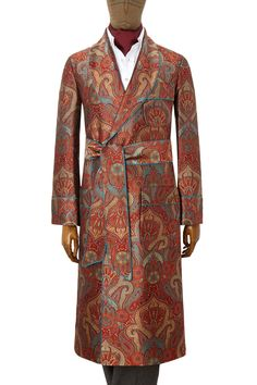<p><p>Handmade in England, the richly coloured silk brocade of this dressing gown is quite stunning. Featuring deep burnt orange and gold hues, with turquoise accents throughout. It has patch pockets and gauntlet cuffs and is lined in a turquoise satin.<p><p> However, if the size you require is not available from our current stock, we are able to make special orders for many of them. Upon order, the fabrics are commissioned to be woven and the gown then made by hand. This process will…