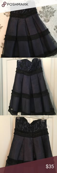 BCBGeneration Black and Blue Lace Strapless Dress Dress is in excellent used condition and it's perfect for cocktails and holidays. BCBGeneration Dresses Strapless