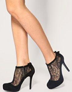 Adorable black lacy ankle booties.