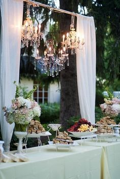 chandeliers behind dessert table