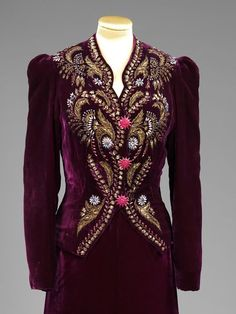 Evening ensemble (detail) | Elsa Schiaparelli (Italian, 1890-1973) | France, 1938 | Silk velvet, embroidered with rhinestones, sequins and silver-gilt threads, fastened with metal buttons | This jacket shows how Schiaparelli used historical and traditional embroideries, including magnificent ecclesiastical vestments, as sources of inspiration. The deep hue of the silk velvet sets off the rich golds of the baroque design perfectly | VA Museum, London