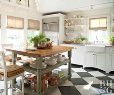 A few modern touches aside, this homey kitchen hearkens back to merry old England with its painted island and open shelves displaying dishes and glassware. Putting the everyday on display is a hallmark of English cottage style and a dapper combination of pretty and practical. A black and white checkered floor furthers the countryside vibe.