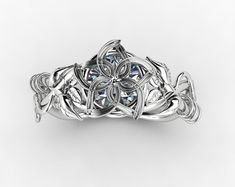 Elegant Gem Covered Engagement Ring with Vines and Leaves Band