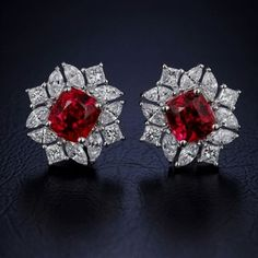 Alluring Handmade Real Diamond Ruby Earrings made up in 18 K Gold. The Diamond Weight is ct. The Diamond Color is G Color, Vs Clarity. The total Ruby Weight is 10 ct. Ruby Jewelry, Emerald Earrings, Diamond Jewelry, Fine Jewelry, Stud Earrings, Jewellery Box, Jewellery Shops, Jewelry Stores, Emerald Pendant