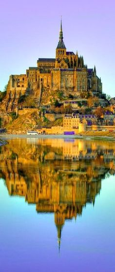 Mont-Saint Michel at dusk in Normandy, France.   Mont Saint Michel at Dusk.  Grab a copy of the best French phrasebook ever https://store.talkinfrench.com/product/french-phrasebook/