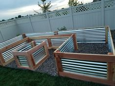 Used redwood and galvanized sheet metal. Measures 4 ft W x 8 ft x 16 ft x 27 in H. - Fresh Gardening Ideas