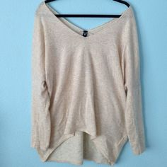 Oversized beige sweater Oversized sweater. Best fits any size since its oversized. Long in the back than front. Off the shoulder. SUPER soft and stretchy. Not Brandy Brandy Melville Tops