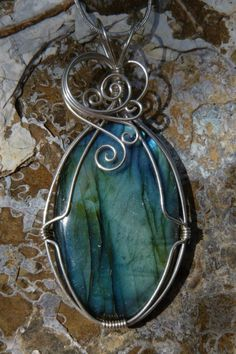 Labradorite necklace in argentium sterling silver.. wire wrapped pendant.