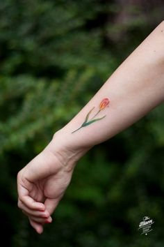 The small tulip it is a floral tattoo made by Magdalena Bujak from Ink Miners Tattoo.