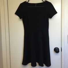 Black babydoll dress Black ribbed babydoll dress. Short sleeved. The perfect LBD. It's versatility allows you to dress it up or down for any occasion Forever 21 Dresses