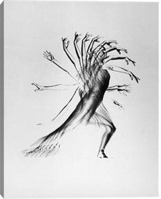 Negative image of stroboscopic study of an arm move by photographer Gjon Mili