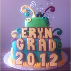 A grad cake with school colours for letters