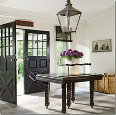 Oh these doors - these amazing doors! Complete with the gas light style chandelier... I've died and gone to foyer heaven!