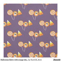 Halloween fabric with orange skulls, candy, cake