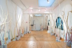not tom: 'the full effect of the installation is that of a strange woolen forest, with a subtle, colourful glow around the bottom of the room. we liked that the mummification in wool of the dead branches is juxtaposed by the capillary action re-creating the natural movement of water up a living branch.'