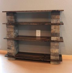 BestPinterest: Make your own diy bookshelf out of concrete blocks and wood. A great idea for outside storage too. #home #decor