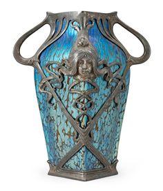 ❤ - Loetz   A metal mounted Loetz iridescent glass vase - Art Nouveau.