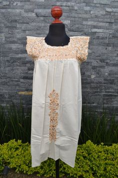 This lovely white dress was handmade in Mexico. The beautiful colorful flowers were embroidered by hand, so each one is unique. You will love wearing this comfortable cotton dress with short sleeves. It is perfect for a hot summer day. This dress comes just above or below the knee, depending on how Mexican Embroidered Dress, Embroidered Clothes, Embroidered Blouse, Mexican Outfit, Mexican Dresses, Mexican Clothing, Traditional Mexican Shirts, Ethnic Dress, Beautiful Blouses