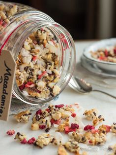 Low carb granola with macadamia nuts, coconut flakes, and cacao nibs collide with freeze dried strawberries and raspberries to create a great low carb breakfast sensation! This recipe makes a great breakfast, snack or dessert and is low carb, gluten-free, dairy-free, Paleo, Keto and THM!