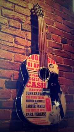 Johnny Cash one-of-a-kind guitar by Todd Perkins. Visit our store at Marathon Village in Nashville, TN.