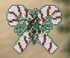 Mill Hill Candy Canes - Beaded Cross Stitch Kit. Kit Includes: Beads, treasures, 14 ct perforated paper, floss, needles, magnet, chart and instructions. Finishe