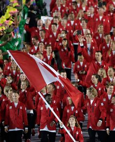Rosie MacLennan carries the flag as she leads Canada into the opening ceremonies for the 2016 Summer Olympics Friday, Aug. 2016 in Rio de Janeiro, Brazil. (Frank Gunn / THE CANADIAN PRESS) Rio Olympics 2016, Summer Olympics, Rio Olympics Opening Ceremony, Happy Canada Day, Rio 2016, Summer 2016, Pride, Brazil, Flag
