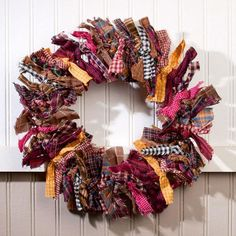 Primitive Rag Wreath. Strips of colorful fall-themed gingham, plaid, and checks tied and wrapped into a homespun wreath. A beautiful Fall door or mantle accent.